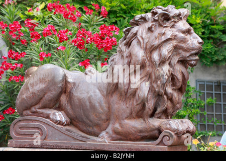 One of a pair of large imposing bronze lions in Positano on the Amalfi Coast in Italy - Stock Photo