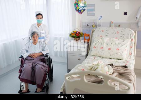 Portrait of a female nurse taking care of a female patient - Stock Photo