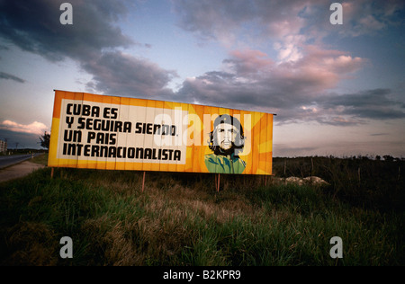 Poster on the roadside promoting Cuba with picture of Che Guevara inside the sun - Stock Photo
