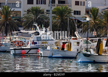 Fishing boats moored at pier in Cala Ratjada, Majorca, Spain - Stock Photo