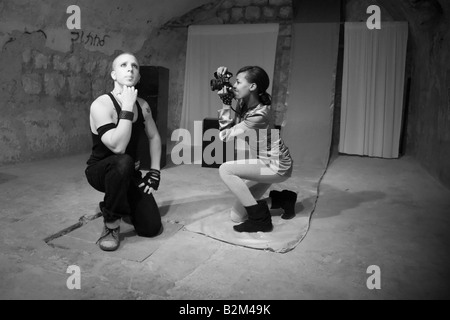 Actors Eyal Ackerman and Barhan Mekonen of the Martef Theatre in Faust by Johann Wolfgang von Goethe - Stock Photo