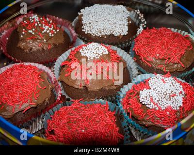 Homemade iced buns in tin - Stock Photo