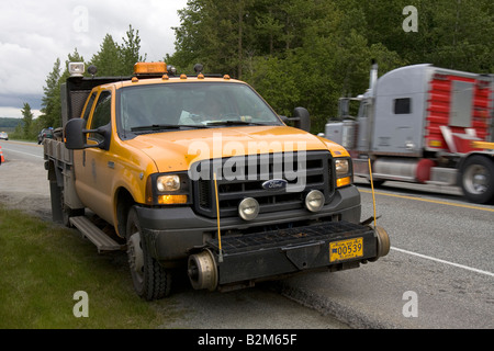 Special prepared car for moving over train tracks parked along the road - Stock Photo