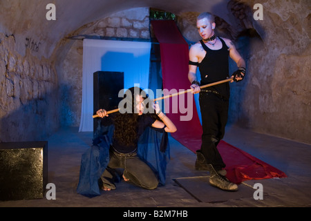 Actors Bar Benyamin and  Eyal Ackerman of the Martef Theatre in Faust by Johann Wolfgang von Goethe - Stock Photo