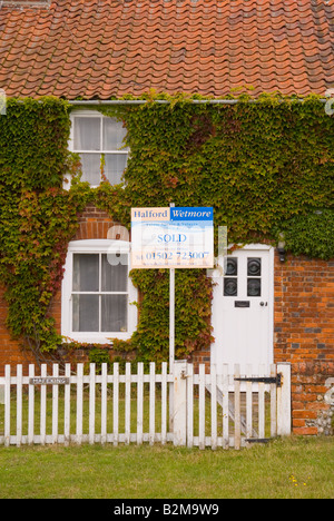 House At Walberswick With Estate Agents Board In Garden (Sold) - Stock Photo