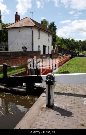 canal narrowboat in bumble hole lock on the staffordshire and worcestershire canal wombourne england uk - Stock Photo