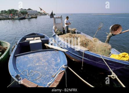 boats and fisherman, porto cesareo, Italy - Stock Photo