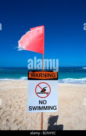 Danger No swimming Beach Closed Sign Sunset Beach North Shore Oahu Hawaii - Stock Photo
