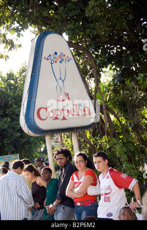 Cubans in long queue waiting to go inside the famous ice cream parlor Coppelia in Verdado Havana Cuba - Stock Photo