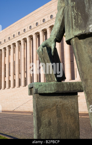 The Parliament building with the monument to K J Stahlberg the 1st president of Finland Helsinki Finland - Stock Photo
