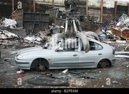 Scrap Car Crushed In A Metal Crusher Ready For Recycling