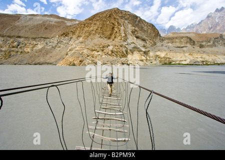 Cable Bride on Two Bridges Walk near Passu on the Karakorum Highway in Northern Pakistan - Stock Photo