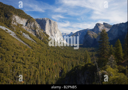 Morning view of Yosemite Valley under beautiful skies from Tunnel View viewpoint with Half Dome in the distance - Stock Photo