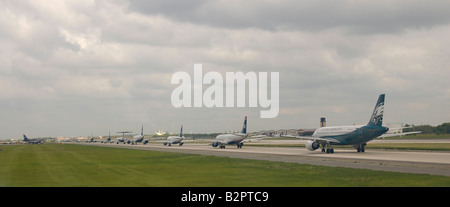 A line of planes ready for take off in Philadelphia Airport - Stock Photo