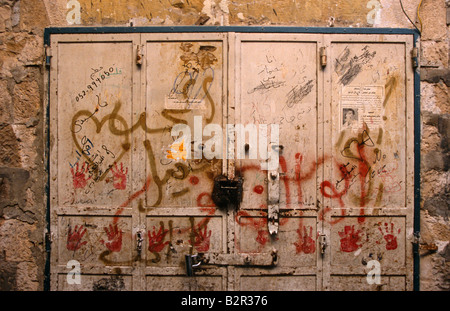 Scribbling and stickers on doors, Jerusalem - Stock Photo