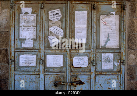 Posters and stickers on doors, Israel - Stock Photo