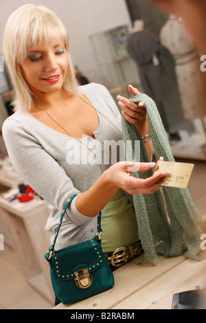 Young woman paying with credit card - Stock Photo