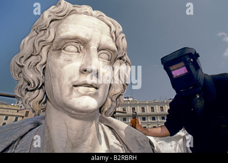 COLUMBUS S GENOA 1992 A WORKER RESTORING STATUE OF COLUMBUS IN GENOA FOR THE EXPO 1992 - Stock Photo