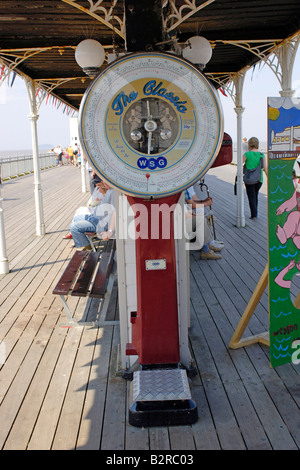 Old fashioned Weighing scales on the pier at Weston Super Mare - Stock Photo