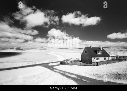 Infrared image of a house next to Seilebost beach, Isle of Harris, Hebrides, Scotland, UK - Stock Photo