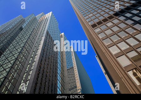 A view of skyscrapers while looking up from the street - Stock Photo