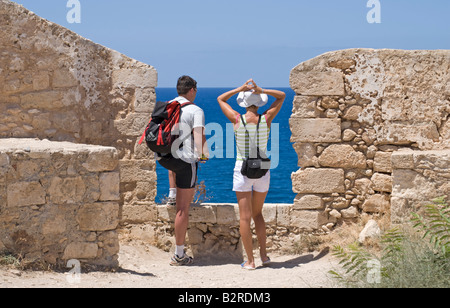 Rethymno, Crete, Greece. 16thC Fortress (Fortezza) Young couple looking out to sea - Stock Photo
