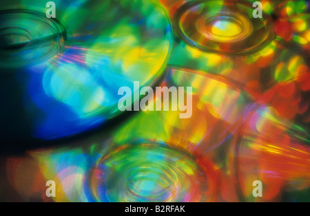 Multi colored stack of cd's reflecting rainbow of colors Marysville Washington State USA - Stock Photo