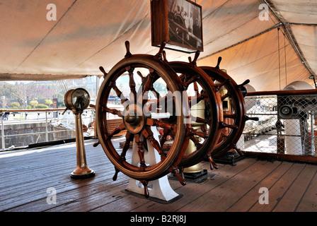 Military frigate. Threefold steering wheel of big sailing boat - Stock Photo