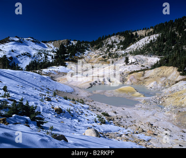 Lassen Volcanic National Park Bumpass Hell thermal pools and snow Northern California USA - Stock Photo