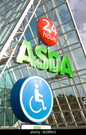 Asda 24 hour superstore atrium, Lower Earley, Reading, Berkshire, UK, showing disabled parking sign in foreground - Stock Photo