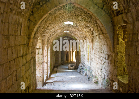 Arched Passageway Inside Crak Des Chevaliers or Al Hosn Crusader Castle in Syria - Stock Photo