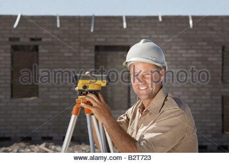 Surveyor on new construction site - Stock Photo