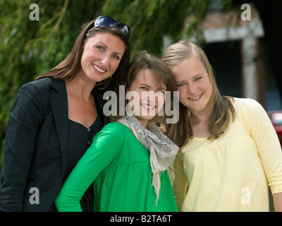 Mother with two teen age girls - Stock Photo