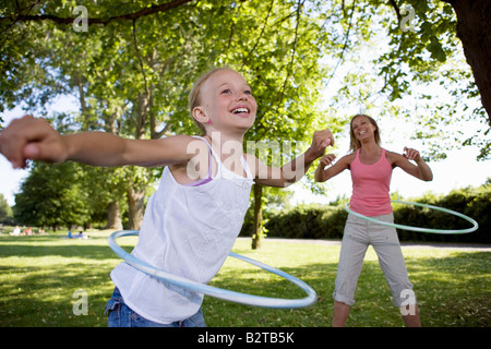 Mother and daughter with hula-hoop - Stock Photo
