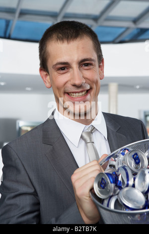 Young businessman with bin - Stock Photo