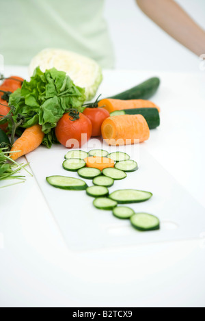Fresh vegetable slices arranged in shape of flower, close-up - Stock Photo