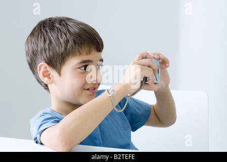 Little boy taking picture with digital camera - Stock Photo