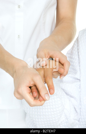 Person receiving hand massage, cropped view - Stock Photo