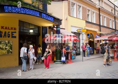 Entrance of the shopping-mall Village, Hundertwasser building, Vienna, Austria - Stock Photo