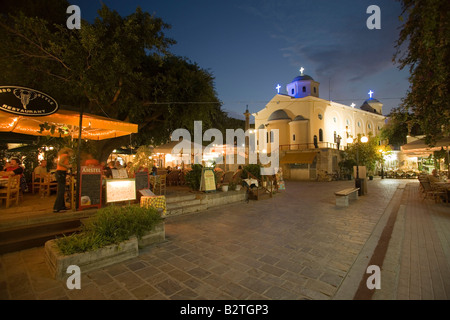 Illuminated restaurant near Agia Paraskevi church at night, Kos-Town, Kos, Greece - Stock Photo