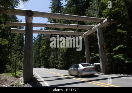 Vehicle entering Mount Rainier National Park Washington WA USA United States of America summer travel tourism mountain - Stock Photo