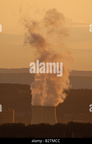 Smokes of electric / coal power plant at Sunset in Germany - Volklingen - Saarland - Stock Photo