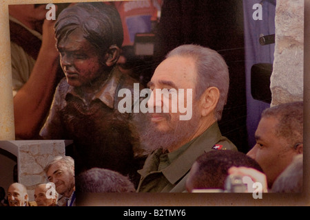 Fidel Castro posing besides a Ernesto Che Guevara boy sculpture in the facade of the Che Guevara museum in Alta Gracia, Cordoba