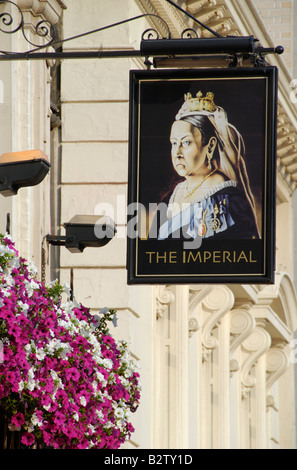 Close up of pub sign showing Queen Victoria outside the Imperial pub, Leicester Street, Soho, London, England - Stock Photo