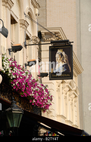 The Imperial pub with sign showing Queen Victoria, Leicester Street, Soho, London, England - Stock Photo