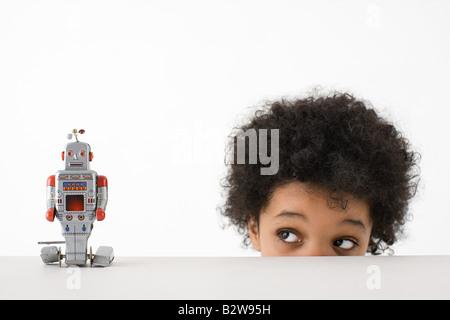 Boy looking at robot - Stock Photo