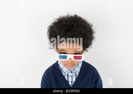 Boy wearing 3D glasses - Stock Photo