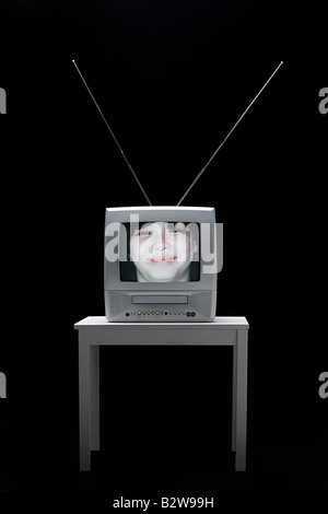 Face of a boy on television - Stock Photo