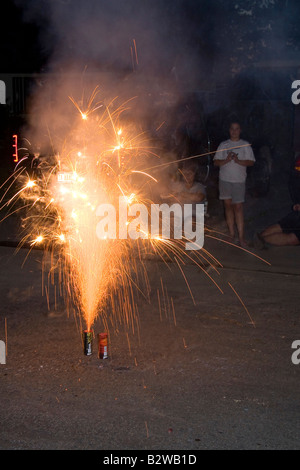 Consumer fireworks lit for Fourth of July neighborhood celebration in Boise Idaho - Stock Photo