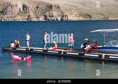 People on a boat dock at Mackay Reservoir in Custer County Idaho - Stock Photo